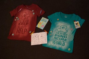 T-shirts, activity book, buttons, crayons